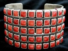 Cuff | Albert Jake ( Ramah Navajo).  Sterling silver with 50 naturally deep red gem quality Mediterranean Coral squares.