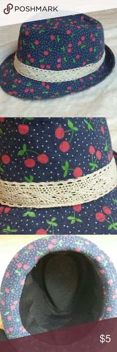"""Girl's Cherry Hat Adorable little girl's hat. Blue with white polka dots and pink cherries. Hardly worn. Took out tag so I do not know brand. Opening measures 7.5"""" x 5.5"""". Accessories Hats"""