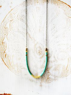 long green gold necklace