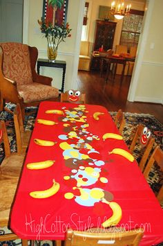 curious george party ... love the idea of having bananas as place settings!