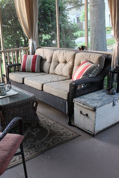 love the screened porch w/ curtains and couch - great layout! I want to recover my rattan chairs with this fabric and add my old chest outside! How perfect for our screened porch!