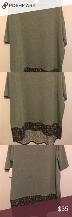Brand new with tags xl Irma Brand new with tags xl Lularoe Irma. Gray with floral design on the bottom. LuLaRoe Tops