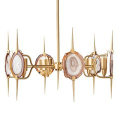 Finish: Satin Brass/Natural Agate  Natural agate slices and satin brass make this show stopping chandelier a statement piece.  Chic, sexy and totally unique!  Emporium Home products are made with natural stones. Variations in the stone colors should be expected and are not considered defects. Stones can be hand selected. Additional fees will apply. Please call for details.