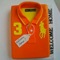 A realistic looking Ralph Lauren Polo Tee. Cake is moist red velvet filled with swiss meringue buttercream