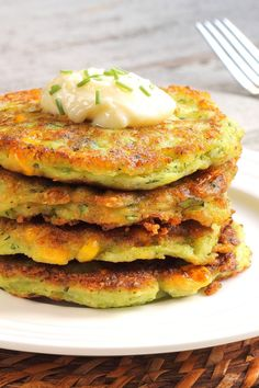 Recipe including course(s): Entrée; and ingredients: baking powder, black pepper, butter, cheddar cheese, corn, cumin, egg, flour, milk, oil, salt, sugar, zucchini