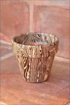 Decoupage wood grain paper on a terra cotta flower pot