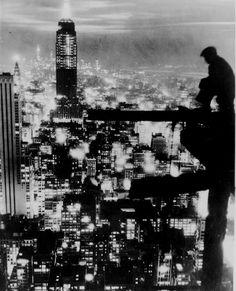 Epic. New York City at night, ca. 1935.