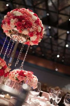 Shades of pink and hanging crystals centerpiece.