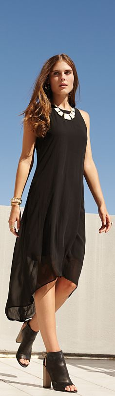 This sleeveless dress from Karen Kane features an above-the-knee lining covered by a sheer layer that falls into a flattering hi-lo silhouette.