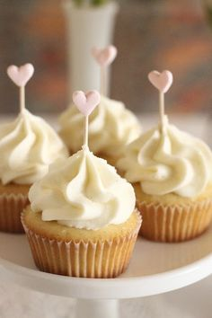 Simple cupcakes with adorable heart toppers - perfect for Valentine's Day by Hello Naomi.