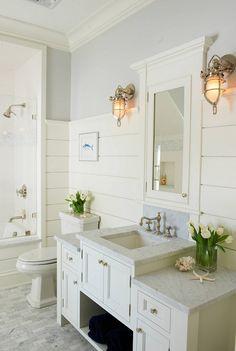 Beach House Bathroom Design with shiplap walls and coastal lighting. Shoreline Painting & Drywall, Inc