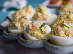 Hard cooked eggs go with so many different flavors well. Deviled eggs are a  fun way to offer an appetizer that guests can just pick up and eat in a  couple of bites. Some mayonnaise and smoked salmon mixed into the yolks in  this recipe make them a little more rich.