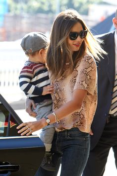 Skinny jeans and sheer blouses,really comfortable to go anywhere with the little prince