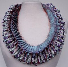 Luis Acosta paper necklace