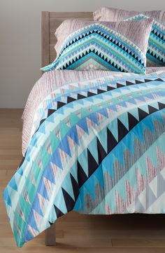 The comforter will become the focal point of the bedroom with this vibrant geometric bedding.