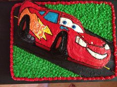 Lightening McQueen 2nd edition  This is the finished product of my second lightening McQueen cake. Made with white cake that was created to look tie dyed when cut into. Homemade buttercream. I did use a cars shaped pan for the cars body.