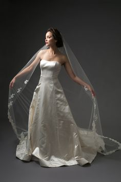 "Chapel length veil with French Alencon lace border and applique embellishment.  ""ADORATION"""