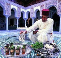 An Arabic Man Pours Moroccan Tea