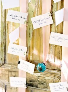 escort cards clipped to hanging ribbons