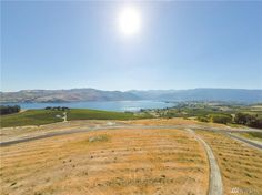Lot D at The Reserve at Lake Chelan. acres with views of Lake and surrounding mountains. Located in the middle of wine country. Wine Country, Country Roads, Vacant Land, Irrigation, Acre, Vineyard, Middle, The Incredibles, Mountains