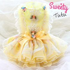 Little Miss Sunshine Couture Dog Dress- Little Miss Sunshine Couture Dog Dress. This sunshine yellow dress is sure to bring a smile to everyone's face. Featuring tutu skirt with pearls, flowers and lace. Note: These couture dresses are made-to-order. Girl Dog Clothes, Cute Dog Clothes, Yorkie, Pomeranian, Dog Dresses, Flower Girl Dresses, Little Miss Sunshine, Dog Clothes Patterns, Pet Boutique