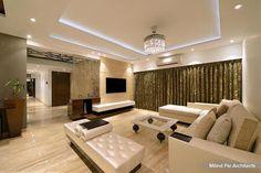 A stunning silver chandelier compliments the sleek white sofa set #livingroom #homedecor #design #sofa #cushions Design Courtesy - Milind Pai Architects, Mumbai
