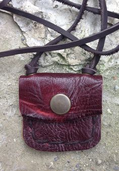 Reddish-brown handmade leather pouch necklace hung from an antiqued leather cord. Pouch width: in cm) Pouch height: in cm) Leather cord: adjustable to 17 in cm) Leather Pouch, Leather Cord, Reddish Brown, Handmade Leather, Sunglasses Case, Swag, Buy And Sell, Antiques, Stuff To Buy