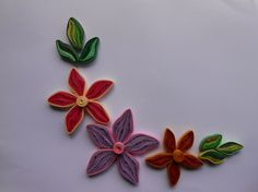 DIY: How to make Quilling flower. Attractive quilled flower with leaves.