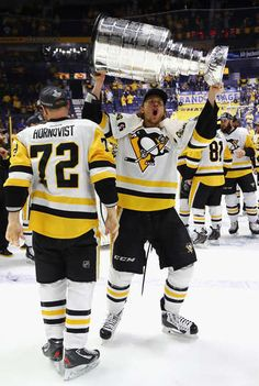 "8c5310dfe lionelsmessi  """"Carl Hagelin of the Pittsburgh Penguins celebrates with the  Stanley Cup trophy after defeating the Nashville Predators in Game Six of  the ..."