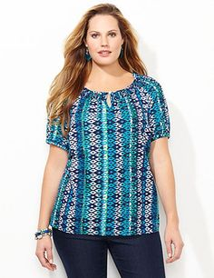 Diamond Stripe Tee | Catherines Bustling with diamond stripes, our beautiful tee adds the perfect pop of pattern to all your favorite bottoms. The smocked scoop neckline has a buttoned keyhole detail for added flair. Short sleeves. Catherines tops are perfectly proportioned for the plus size woman. This style is available in petite plus sizes. #catherines #plussizefashion #springstyle #petitesizes #pluspetite