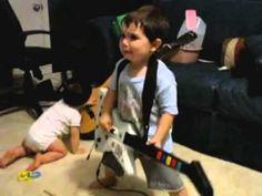 This 2-Year-Old Rocking To Some 'Bulls On Parade' On Guitar Hero Is Stealing The Internet Spotlight Today!
