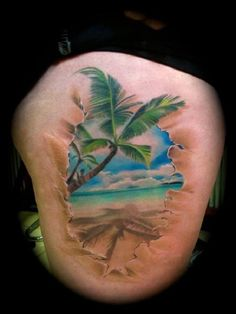 Beautiful beach tattoo with the palm trees and the beach. You can actually feel the wave crashing through the sand with how detailed this design was made.