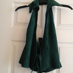 ✅SISLEY-Real Leather hunter green halter vest Fabulous SISLEY hunter green real leather halter vest with collar.. tie front for a perfect fit. Brand new with tags intact. Sisley Tops