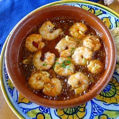 Shrimp and garlic sizzle in oil.   First you catch a tantalizing whiff of garlic. Then, as the cazuelita is set before you, you fe...