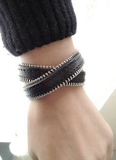Hey, I found this really awesome Etsy listing at http://www.etsy.com/listing/93338980/2-circles-black-leather-wrap-bracelet