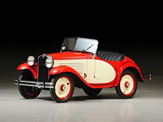 1932 American Austin Roadster. Growing up we had a car like this. It was blue and red. I cried when my dad sold it...