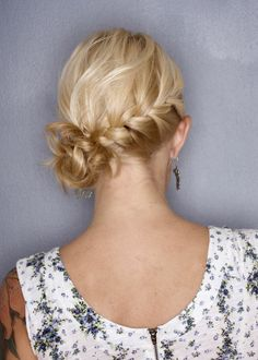 side swept braid tied at lower left nape.  I did a this look for a Salsa Dance edition when the Championship of Ice Skating was in Cleveland years ago.  I loved it!