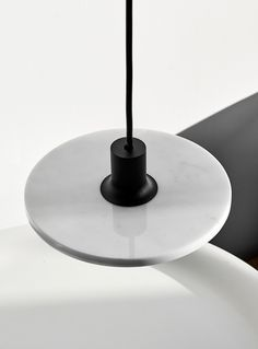 Going back to the origin, no matter if it's an ancient material or pure nothingness, is something product designer Romain Voulet values highly. Suspended Lighting, Ligne Roset, Calcium Carbonate, Keep It Simple, One Design, Light Shades, House Colors, Floor Lamp, Ceiling Lights