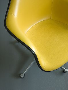 "An Eames Dash 99, with royal decor naugahyde on the back, and Alexander Girard's unique ""hopsak"" on the seat."