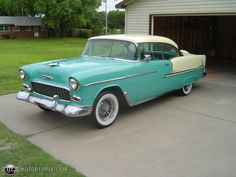 1955 Chevy Bel Air.  Mom and Dad had a light green one with a white roof.  No wheel covers like the one in this picture.