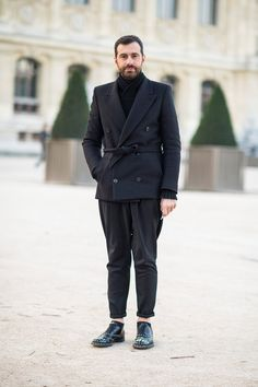 Gianpietro Baudo wears a Maison Martin Margiela jacket, Balenciaga jumper, Givenchy pants and Prada shoes.