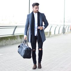 Rips in jeans are a tad too casual for this ensemble, especially given the informality of the tailored cut.