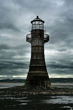 If Mordor ever needed a lighthouse, this would be it.  Old iron Whiteford Point Light, Llanelli, Wales.
