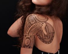 Egyptian tattoo of Thoth on shoulder