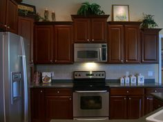 42 inch cherry kitchen cabinets  | Kitchen with 42 in., Upgraded Cherry Cabinets and High-End Stainless ...