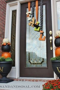 These hanging letters leave plenty of room for creativity. Deck your letters out in Halloween decals or opt for a more subtle fall color scheme instead of a classic wreath.