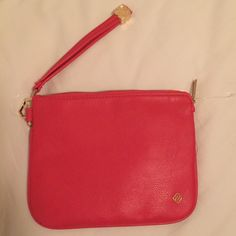 """Kendra Scott red leather wristlet Leather strap. Large wristlet measure 8.25""""x6.5"""". Perfect for a night out! With inside zip pocket. Kendra Scott authentic, never worn, with plastic. Gold hardware. Kendra Scott Bags Clutches & Wristlets"""