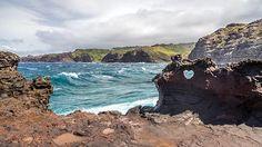 Heart shaped hole in the lava rocks at Nakalele blow hole, island of Maui, Hawaii