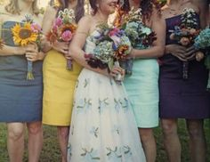 I love these casual bridesmaid garments and wildflower bouquets - they're all different but complimentary of each other and the uniquely patterned garden-inspired wedding dress.