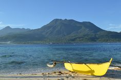 The Hibok-Hibok volcano and the little boat that could. From White Island in Camiguin, the Philippines.